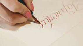 A menina escreve a caligrafia 3 video estoque