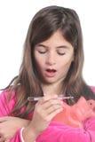 A menina está com uma gripe Imagens de Stock Royalty Free