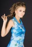A menina está em um vestido azul Imagens de Stock Royalty Free