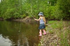 A menina está pescando Foto de Stock Royalty Free