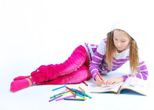 A menina está pintando Fotografia de Stock
