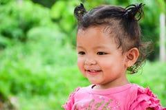 A menina está sorrindo Imagens de Stock