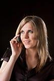 A menina fala no telemóvel fotografia de stock