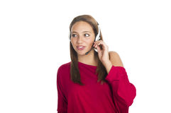 A menina fala pelo telefone móvel Foto de Stock Royalty Free