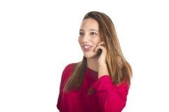 A menina fala pelo telefone móvel Fotos de Stock