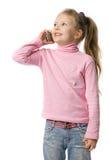 A menina fala pelo telefone móvel Imagem de Stock Royalty Free