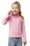 A menina fala pelo telefone móvel Imagens de Stock