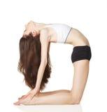 A menina faz exercícios da ioga Fotografia de Stock Royalty Free