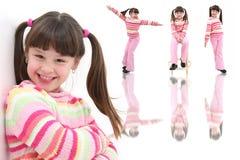 Menina feliz bonita dos anos de idade sete Foto de Stock