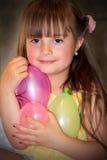 Menina feliz com balões Foto de Stock Royalty Free