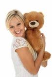 Menina feliz com brinquedo Imagem de Stock Royalty Free