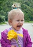 Menina feliz com flor Foto de Stock Royalty Free
