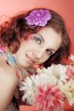 Menina feliz com flores Imagens de Stock