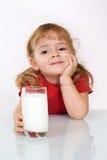 Menina feliz com leite Foto de Stock Royalty Free