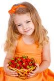Menina feliz com morangos Imagens de Stock