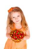 Menina feliz com morangos Fotografia de Stock Royalty Free