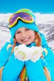 Menina feliz com neve em suas mãos Foto de Stock Royalty Free