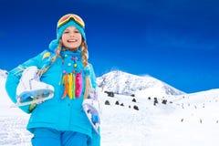 A menina feliz com patina no gelo Imagem de Stock