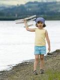 Menina feliz com plano Imagem de Stock