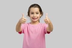 Menina feliz com polegares acima imagens de stock