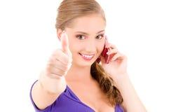Menina feliz com telefone cor-de-rosa Fotografia de Stock Royalty Free