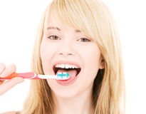 Menina feliz com toothbrush Imagem de Stock Royalty Free