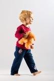 Menina feliz com um brinquedo Imagens de Stock Royalty Free