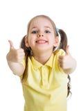 Menina feliz da criança com os polegares das mãos isolados acima imagens de stock royalty free