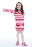 Menina feliz da criança com polegares das mãos acima Imagens de Stock
