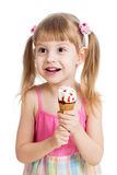 Menina feliz da criança que come o gelado isolado Imagens de Stock Royalty Free