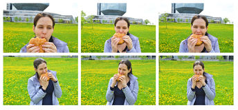 Menina feliz de Beautuful que come o Hamburger. Grupo 1. Fotografia de Stock Royalty Free