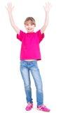 Menina feliz de riso com mãos levantadas acima. fotos de stock