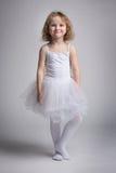 Menina feliz em um vestido do bailado Imagem de Stock Royalty Free