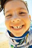 Menina feliz em uma toalha de praia Fotografia de Stock Royalty Free