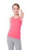 A menina feliz mostra a APROVAÇÃO do polegar. imagens de stock royalty free