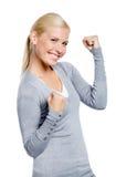 Fêmea feliz com seus punhos acima Imagens de Stock