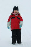 A menina feliz na neve Foto de Stock Royalty Free