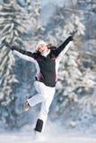 Menina feliz na neve do inverno fotografia de stock royalty free