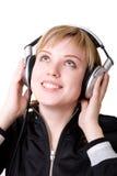 Menina feliz nos fones de ouvido Fotografia de Stock