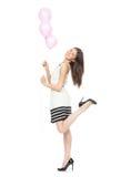 Menina feliz nova com balões como um presente para o aniversário Fotos de Stock
