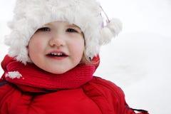 A menina feliz olha a câmera Imagens de Stock Royalty Free