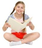Menina feliz pequena com o livro nas mãos Imagem de Stock