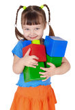 Menina feliz pequena com os brinquedos nas mãos Fotografia de Stock