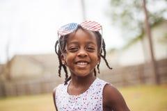 Menina feliz que comemora 4o julho Fotografia de Stock