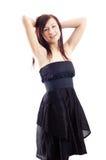 Menina feliz que desgasta um vestido preto Imagens de Stock Royalty Free