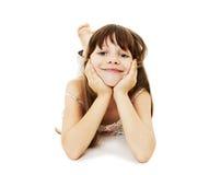 Menina feliz que encontra-se no assoalho imagem de stock royalty free