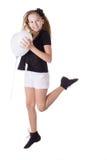 Menina feliz que salta com balão coração-dado forma imagem de stock