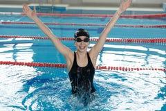 Menina feliz que salta na piscina Imagens de Stock