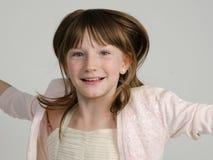 Menina feliz que salta perto acima Fotografia de Stock Royalty Free