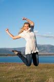 A menina feliz salta Fotos de Stock